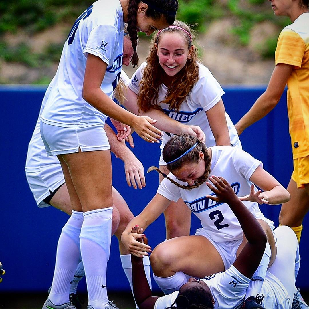 USD women's soccer players celebrate victory